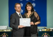 Honourable Dr. Terry Lake, Minister of Health, Province of British Columbia, presents certificate to Lori