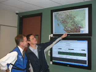 Minister Penner (right) and Allan Chapman, head of the River Forecast Centre